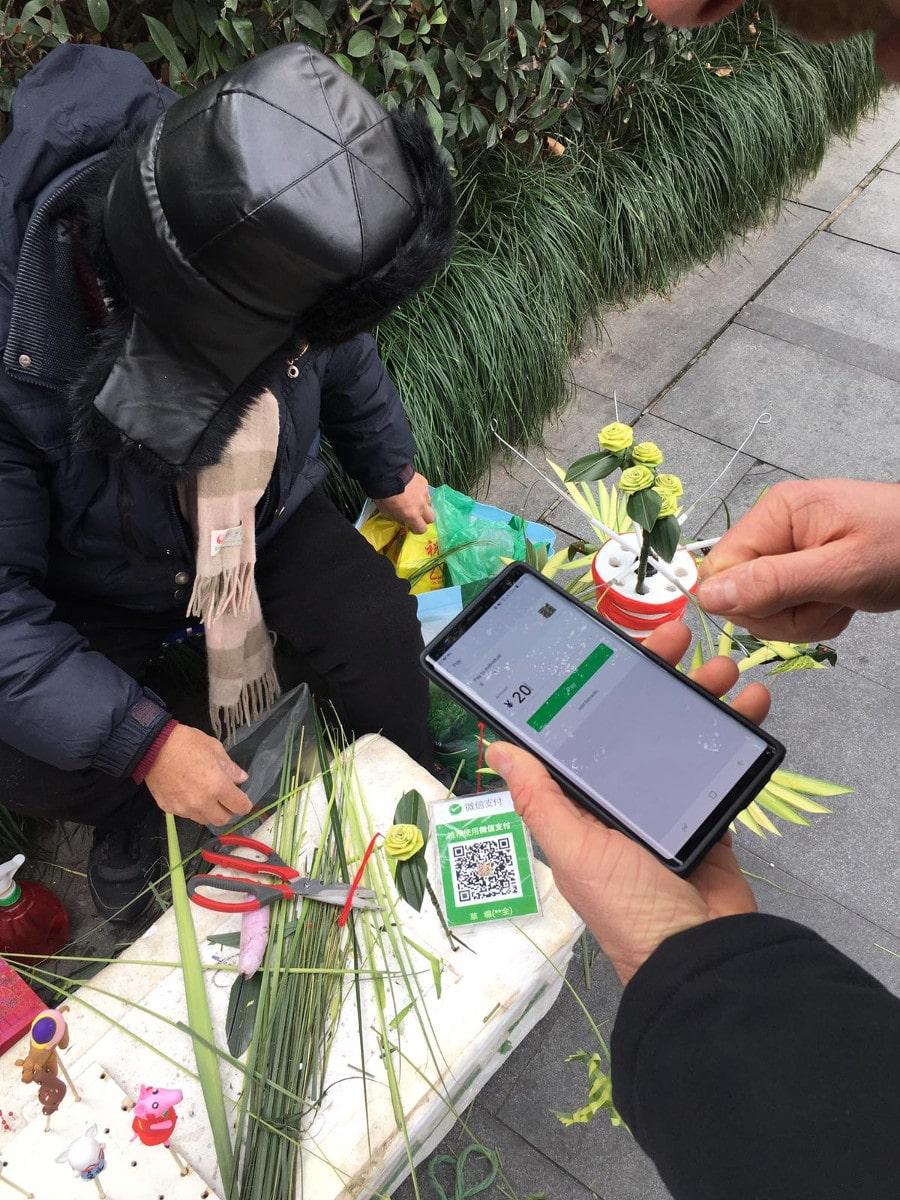 Straßenhändler bezahlen mit WeChat